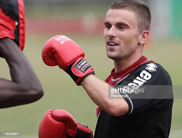 Arron Davies of Northampton Town wears boxing gloves during a training session at Sixfields Stadium on July 4, 2011 in Northampton, England.