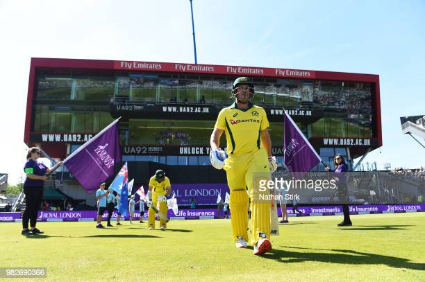 Arron Finch of Australia walks out to bat during the 5th Royal London ODI match between England and Australia at Emirates Old Trafford on June 24...