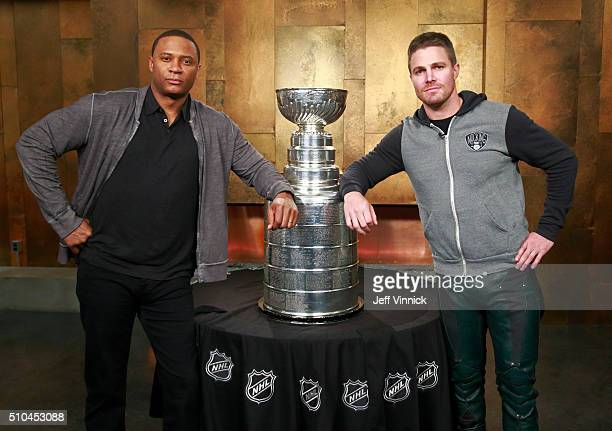 Arrow actors David Ramsey and Stephen Amell pose with the Stanley Cup on the set of Arrow February 15 2016 in Vancouver British Columbia Canada Amell...