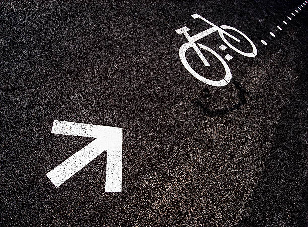 Arrow and bike on tarmac
