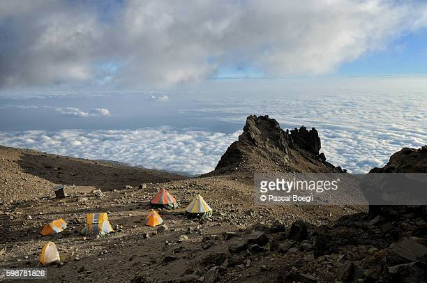 arrow glacier camp above the clouds, kilimanjaro national park - kilimanjaro stock photos and pictures
