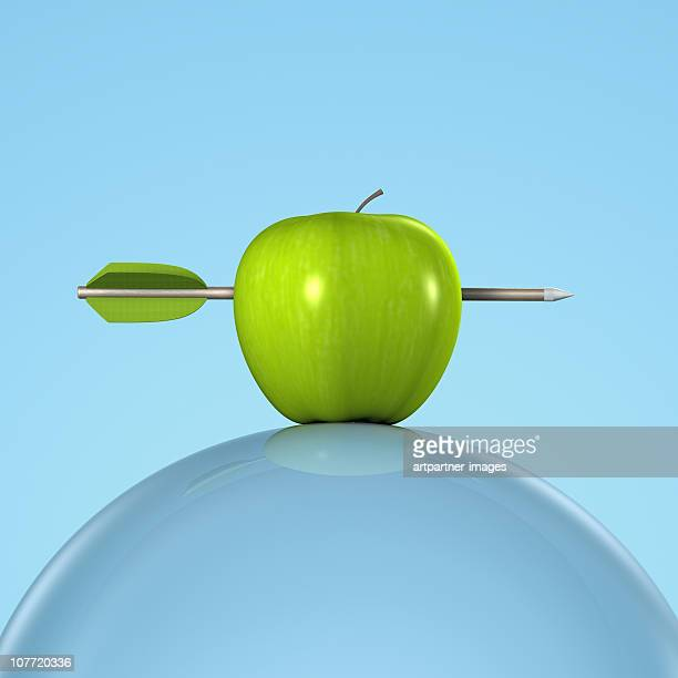Arrow in a Green Apple on a Glass Sphere
