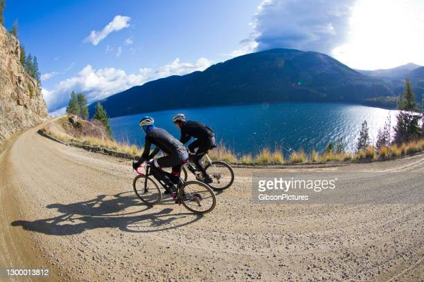 arrow lake gravel road bicycle ride - taking a corner stock pictures, royalty-free photos & images