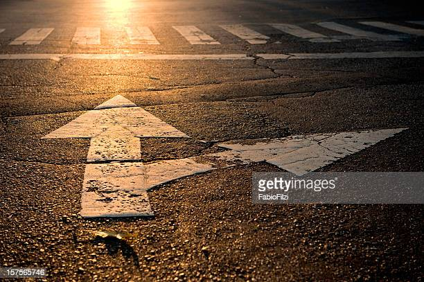 arrow on road - fork stock pictures, royalty-free photos & images