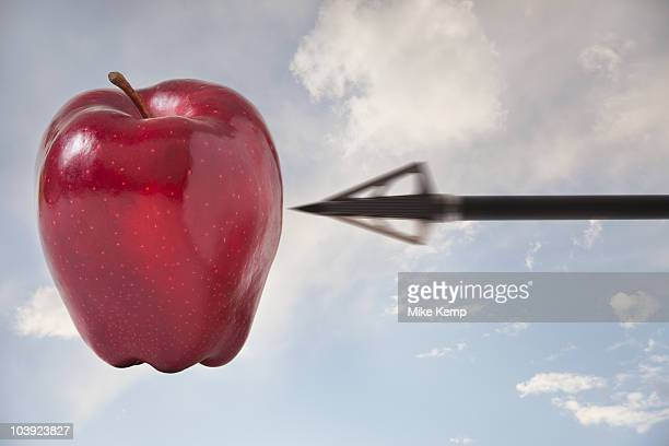 Arrow pointing at apple in the sky