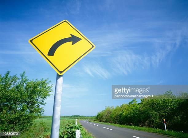 arrow sign on a country road, bekkai, hokkaido, japan - plusphoto stock pictures, royalty-free photos & images