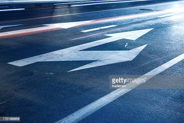 Arrow signs on asphalt