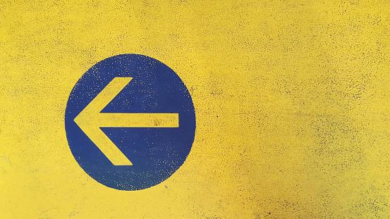Arrow symbol painted on asphalt in parking garage - gettyimageskorea