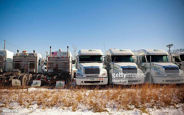 Arrow Trucking Co tractors are stored on a lot near a Freightliner dealership in Tulsa Oklahoma US on Monday Jan 4 2010 Arrow Trucking Co the...