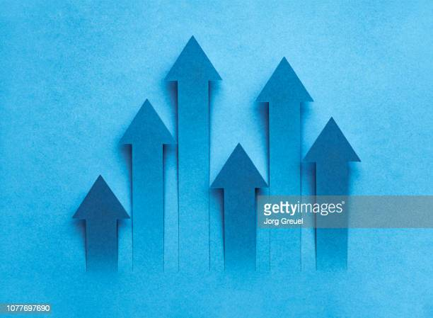 arrows cut out from a sheet of paper - medium group of objects stock pictures, royalty-free photos & images