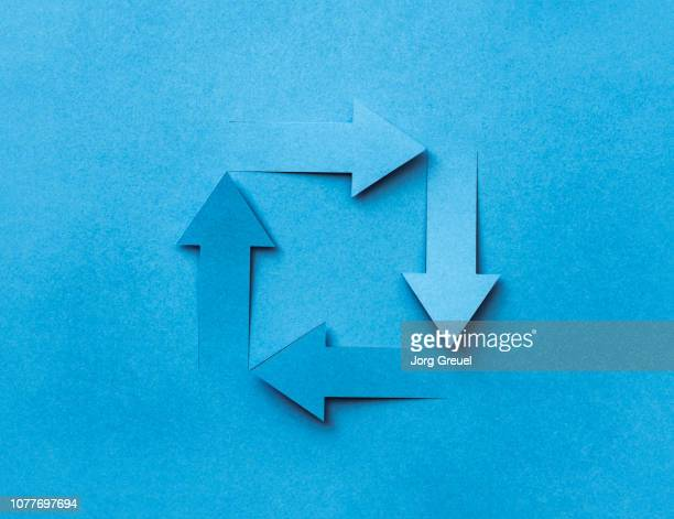 arrows cut out from a sheet of paper - following arrows stock pictures, royalty-free photos & images