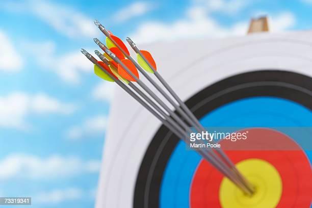 Arrows in bullseye of target, focus on arrows, close up
