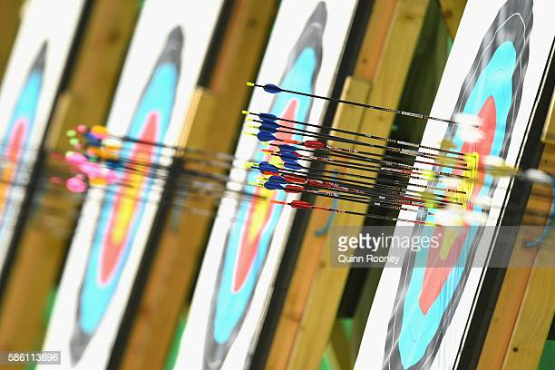 Arrows on the board are seen during the Men's Individual Ranking Round on Day 0 of the Rio 2016 Olympic Games at the Sambodromo Olympic Archery venue...