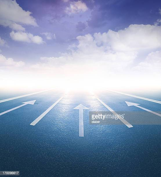 arrows pointing into bright light - brightly lit stock photos and pictures