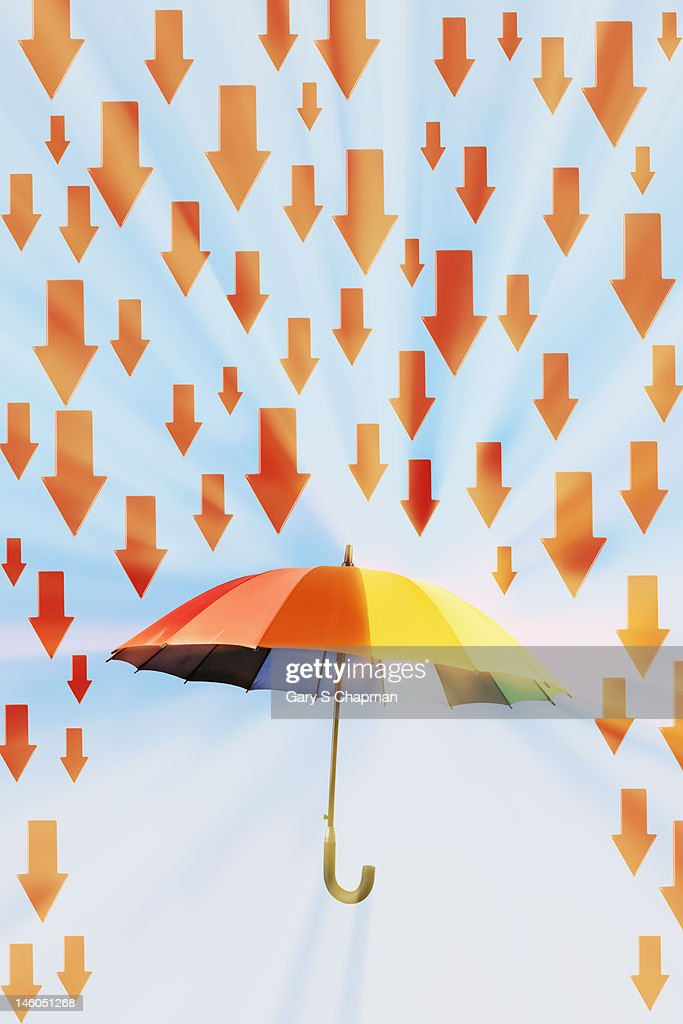 Arrows Raining Down On Rainbow Umbrella Stock Photo Getty Images