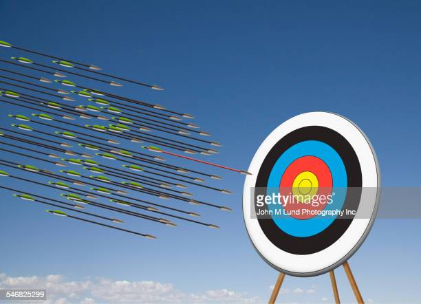 arrows shooting towards target in blue sky - john lund stock pictures, royalty-free photos & images