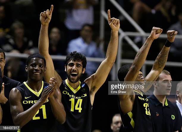 Arsalan Kazemi of the Oregon Ducks and teammates celebrate from the bench during the second half of their 74 to 57 win over the Saint Louis Billikens...
