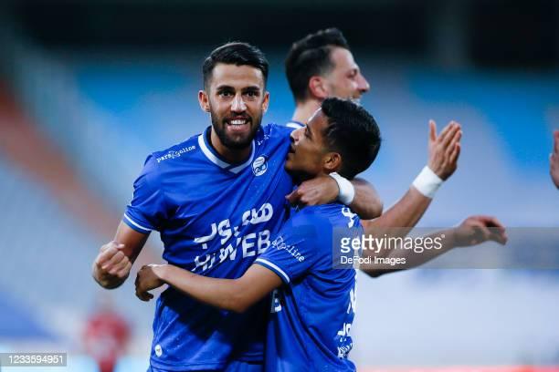 Arsalan Motahari, Mehdi Ghayedi and Arman Ramezani of Esteghlal celebrates after scoring his teams first goal with team mates during the Persian Gulf...