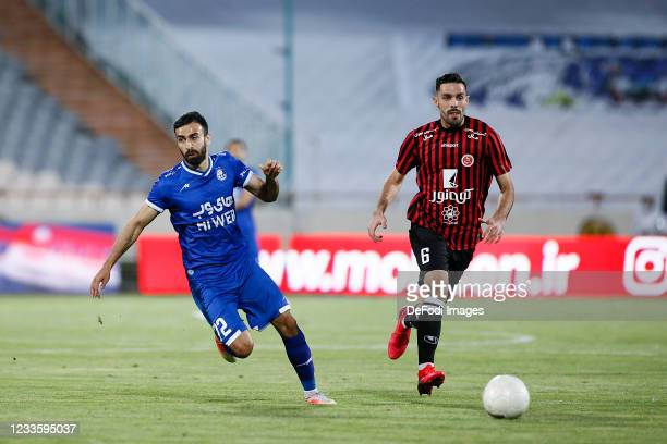 Arsalan Motahari of Esteghlal and Mohammad Erfan Masoumi of Padideh battle for the ball during the Persian Gulf Pro League match between Esteghlal...