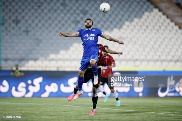 Arsalan Motahari of Esteghlal battle for the ball during the Persian Gulf Pro League match between Esteghlal and Padideh FC at Azadi Stadium on June...