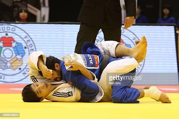 Arsen Galstyan of Russia holds Baul An of Korea in the Men's 66kg preliminary at Tokyo Metropolitan Gymnasium on December 4 2015 in Tokyo Japan