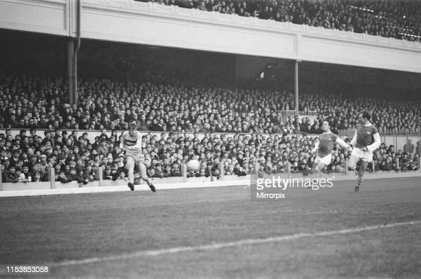Arsenal 0 West Ham 0 Harry Redknapp on the right wing for West Ham gets a cross in chased by two Arsenal players at Highbury London Picture taken...