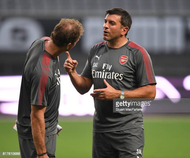 Arsenal 1st team coach Jens Lehmann and Sal Bibbo before a training session at the Shanghai Stadium on July 18 2017 in Shanghai China