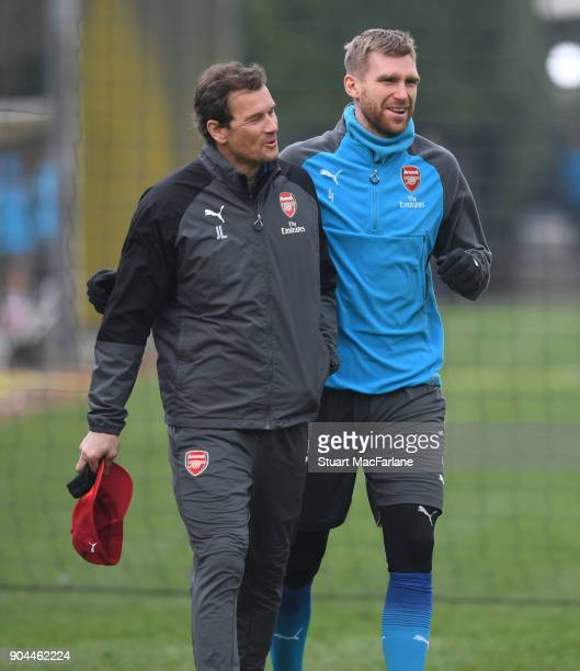 Arsenal 1st team coach Jens Lehmann with Per Mertesacker during a training session at London Colney on January 13 2018 in St Albans England