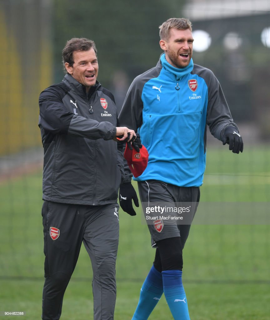 Arsenal 1st team coach Jens Lehmann with Per Mertesacker during a training session at London Colney on January 13, 2018 in St Albans, England.