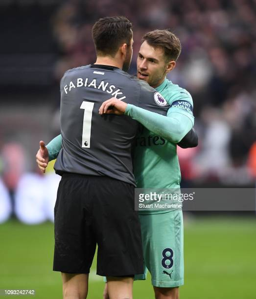 Arsenal Aaron Ramsey hugs former team mate West Ham goalkeeper Lucasz Fabianski after the Premier League match between West Ham United and Arsenal FC...