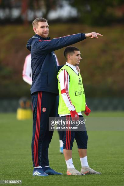 Arsenal Academy Director Per Mertesacker with Lucas Torreira during a training session at London Colney on November 30, 2019 in St Albans, England.