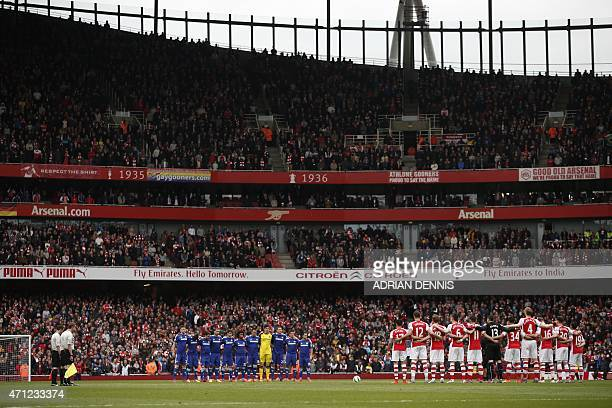 Arsenal and Chelsea stand for a minutes silence in commemoration of the 1980 Bradford city fire before the English Premier League football match...