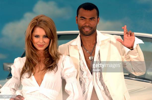 Arsenal and England footballer Ashley Cole and his fiancee Cheryl Tweedy from Girls Aloud had their fingers crossed today to launch the National...