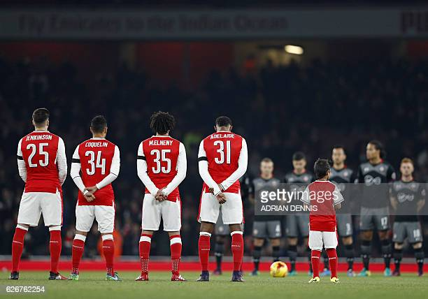 Arsenal and Southampton players pause for a one minute silence in honour of the victims of a plane crash which was carrying aboard it members of the...
