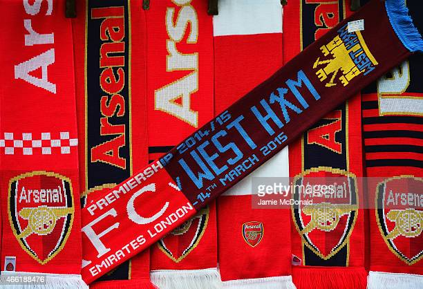 Arsenal and West Ham scarves are sold on a merchandise stall prior to the Barclays Premier League match between Arsenal and West Ham United at...