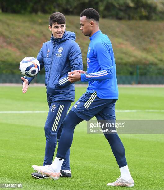 Arsenal assistant coach Carlos Cuesta with Gabriel during a training session at London Colney on May 08, 2021 in St Albans, England.