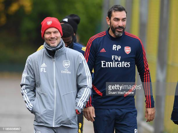Arsenal assistant coach Freddie Ljungberg with ex player Robert Pires before a training session at London Colney on November 05 2019 in St Albans...
