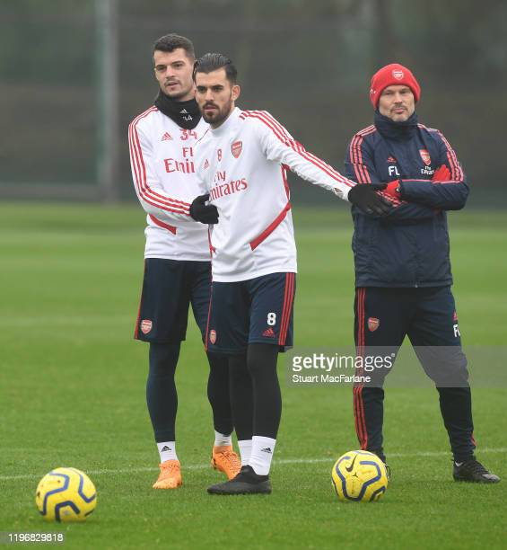 Arsenal assistant coach Freddie Ljungberg with Granit Xhaka and Dani Ceballos during a training session at London Colney on December 31 2019 in St...
