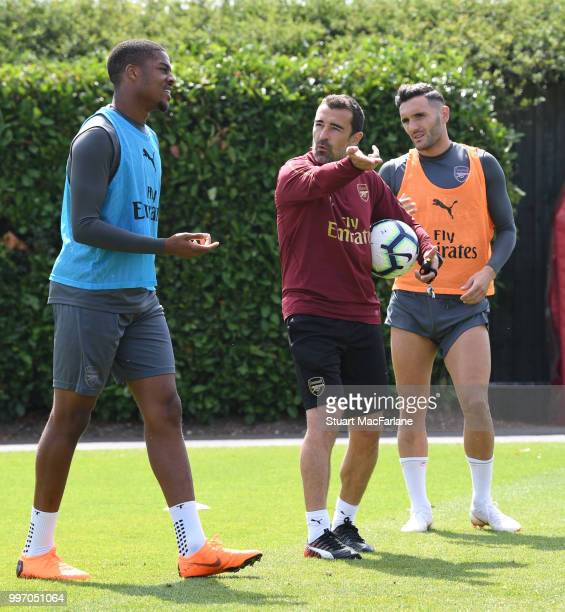 Arsenal assistant coach Juan Carlos Carcedo with Chuba Akpom and Lucas Perez during a training session at London Colney on July 12 2018 in St Albans...