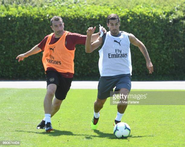 Arsenal Assistant Head Coach Juan Carlos Carcedo and Henrikh Mkhitaryan during a training session at London Colney on July 3 2018 in St Albans England