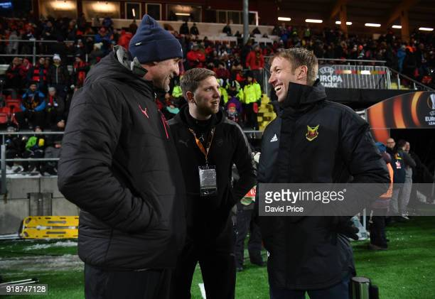 Arsenal Assistant Manager Steve Bould chats to Ostermunds Manager Graham Potter before UEFA Europa League Round of 32 match between Ostersunds FK and...