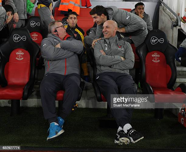Arsenal assistant manager Steve Bould talks with substitute Emiliano Martinez and 1st team coach Neil Banfield the Emirates FA Cup Fourth Round match...