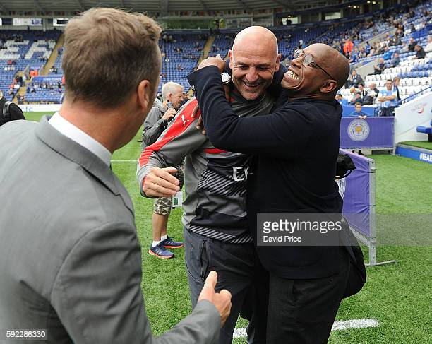 Arsenal Assistant Manager Steve Bould with former Arsenal team mates Lee Dixon and Ian Wright before the Premier League match between Leicester City...