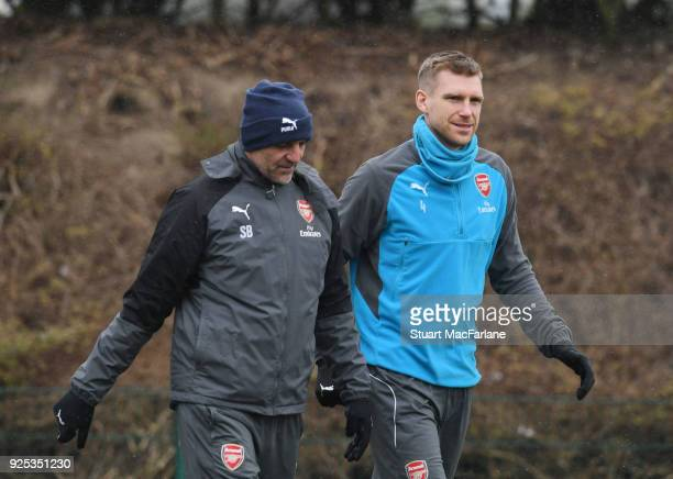 Arsenal assistant manager Steve Bould with Per Mertesacker before a training session at London Colney on February 28 2018 in St Albans England
