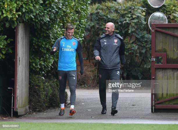 Arsenal assistant manager Steve Bould with Rob Holding during training at London Colney on March 10 2018 in St Albans England