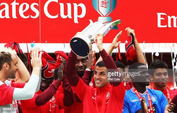 Arsenal captain Cesc Fabregas lifts the Trophy following his team's victory during the Emirates Cup match between Arsenal and Glasgow Rangers at the...