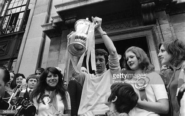 Arsenal captain Frank McLintock holds up the FA Cup trophy upon a triumphant return to Highbury North London after Arsenal's 21 victory over...