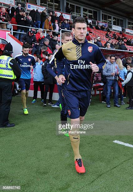 Arsenal captain Laurent Koscielny runs out of the tunnel for the warm up before the Barclays Premier League match between AFC Bournemouth and Arsenal...