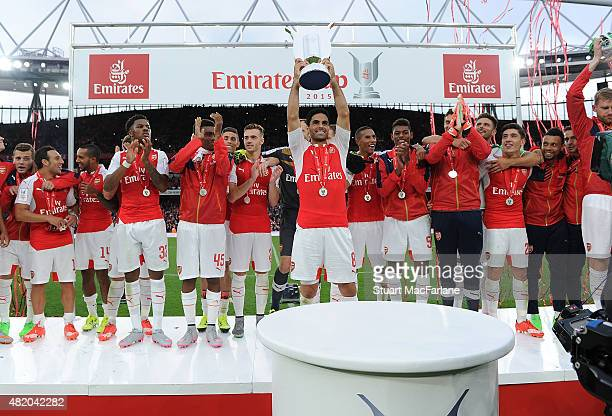 Arsenal captain Mikel Arteta lifts the Emirates Cup after at the match between Arsenal and Wolfsburg at Emirates Stadium on July 26 2015 in London...