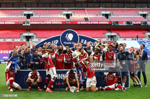 Arsenal captain Pierre-Emerick Aubameyang of Arsenal drops the FA Cup Trophy following the FA Cup Final match between Arsenal and Chelsea at Wembley...